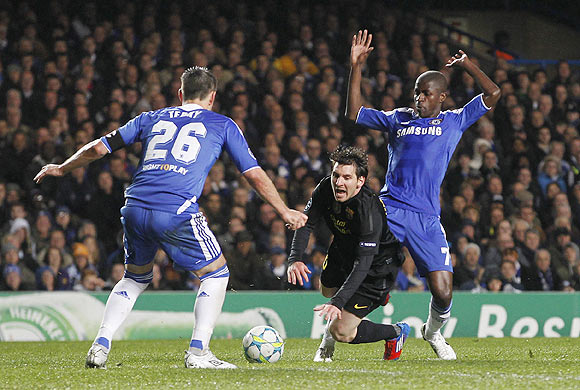 Ramires (right) of Chelsea fouls Lionel Messi of Barcelona