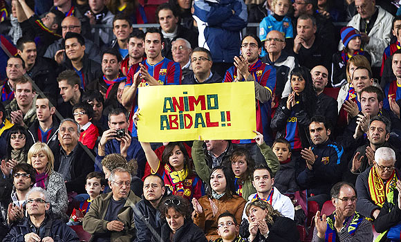 Barcelona fans display a banner in support of Eric Abidal