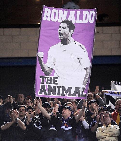 A Real Madrid fan holds up a banner of Cristiano Ronaldo