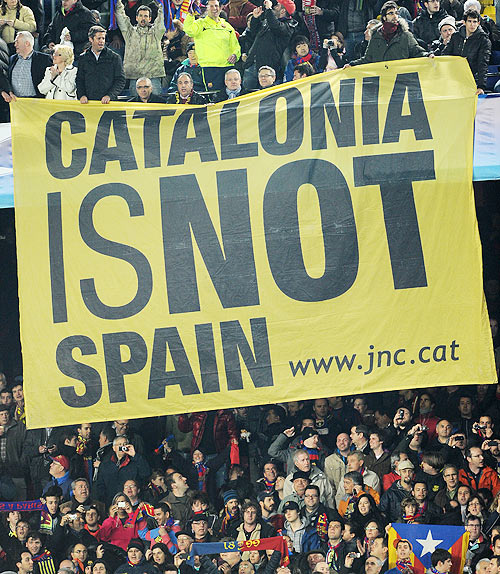 Barcelona supporters hold up a banner reading 'Catalunya is not Spain'