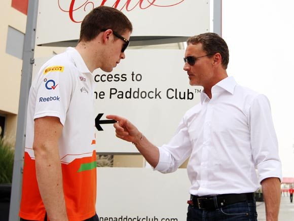 Force India driver Paul di Resta (left) speaks with former F1 driver and BBC commentator David Coulthard