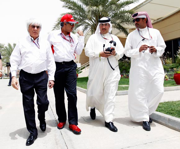 (Left to right): F1 supremo Bernie Ecclestone, Zayed Rashed Al Zayani the Director of Bharain International Circuit, Sheikh Mohammed bin Essa Al Khalifa the CEO of the Bahrain Economic Development Board and McLaren shareholder and Salman Bin Isa Al Khalifa the Acting Chief Executive Officer of the Bahrain International Circuit walk in the paddock during practice