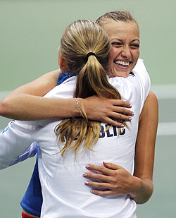 Czech Republic's Petra Kvitova and Lucie Safarova (left) celebrates the team's victory over Italy