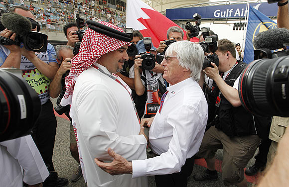 Crown Prince Sheikh Salman bin Hamad al-Khalifa greets Formula One supremo Bernie Ecclestone before the Bahrain F1 Grand Prix