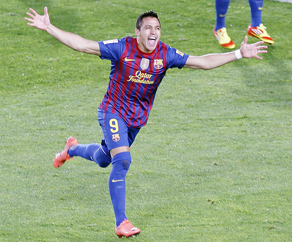 Barcelona's Alexis Sanchez celebrates after scoring the equalser against Real Madrid