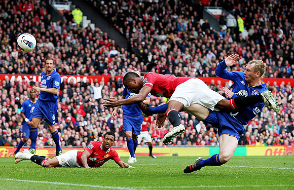 Patrice Evra of Manchester United hits the post