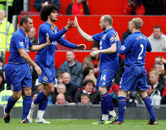 Marouane Fellaini of Everton celebrates scoring his team's second goal with his team-mates