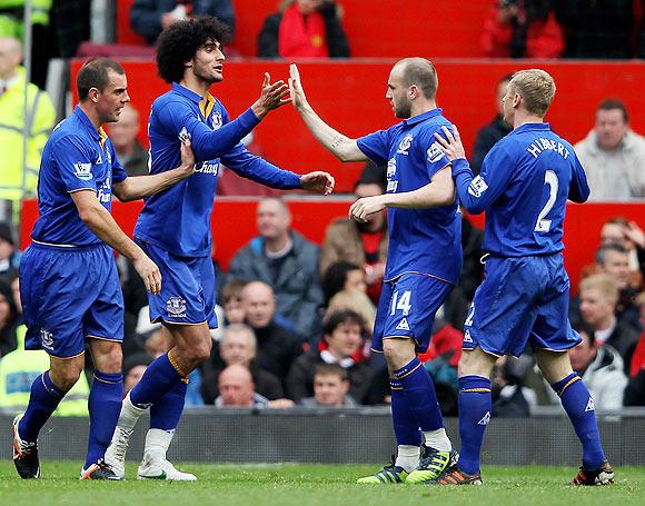 Marouane Fellaini of Everton celebrates scoring his team's second goal with his team-mates