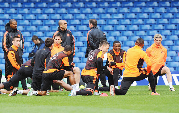 Chelsea players warm up during a training session ahead of their UEFA Champions League semi-final against Barcelona