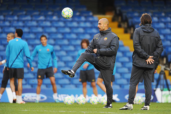 Coach Pep Guardiola of Barcelona shows off his footballing skills during a training session ahead of their UEFA Champions League semi-final against Chelsea