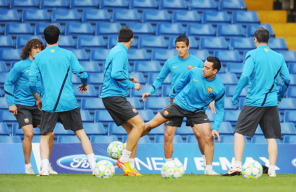 Xavi Hernandez (centre) of Barcelona in action during a training session