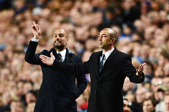 Roberto Di Matteo, caretaker manager of Chelsea gestures with Josep Guardiola, coach of Barcelona