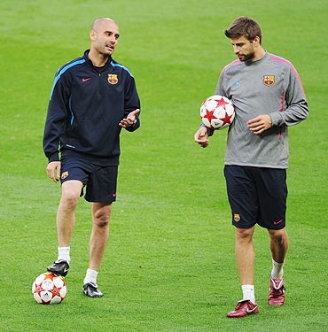 Pep Guardiola with Gerard Pique