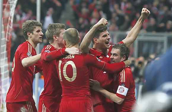 Bayern Munich players celebrate after winning the match