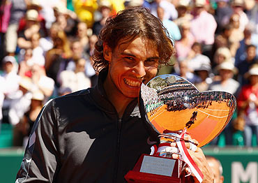 Rafael Nadal with the trophy after beating Novak Djokovic at the Monte Carlo Masters on Sunday
