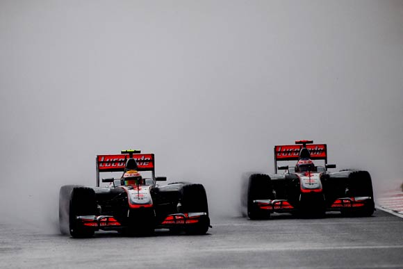 McLaren's Lewis Hamilton (left) next to his team-mate Jenson Button
