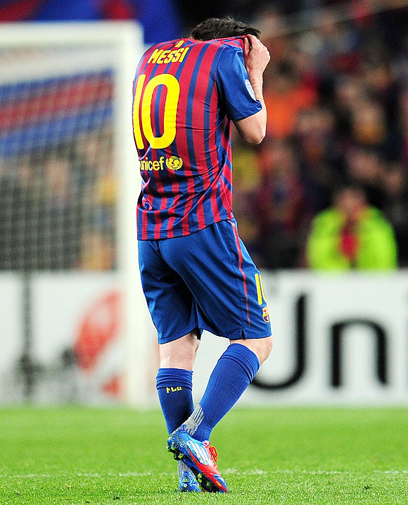 Lionel Messi reacts after missing the penalty on Tuesday