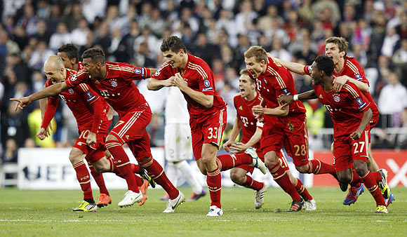 Bayern Munich's players react after beating Real Madrid via penalties in their Champions League semi-final on Wednesday