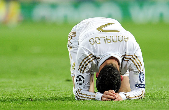 Cristiano Ronaldo reacts after missing a penalty during the shootout
