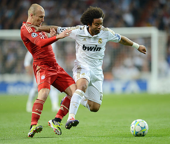 Bayern Munich's Arjen Robben and Real Madrid's Marcelo vie for possession