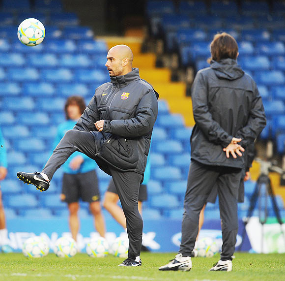 Coach Pep Guardiola of Barcelona shows off his footballing skills
