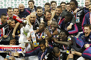 Olympique Lyon's players celebrate after defeating Quevilly to win the French Cup final on Saturday
