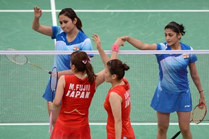 Ashwini Ponnappa (top right) and Jwala Gutta (left) shake hands with Mizuki Fujii (bottom left) and Reika Kakiiwa (right) of Japan after losing their women's doubles match.