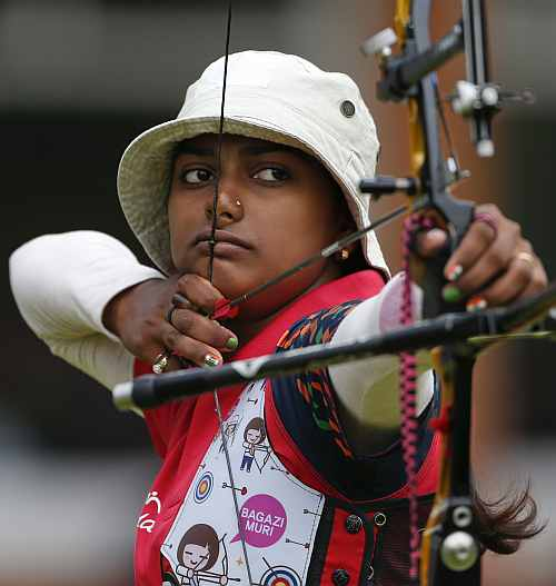 Deepika Kumari of India aims during the women's individual round of 32 eliminations at the Lord's Cricket Ground