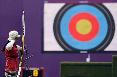 India's Deepika Kumari shoots during an elimination round of the individual archery competition