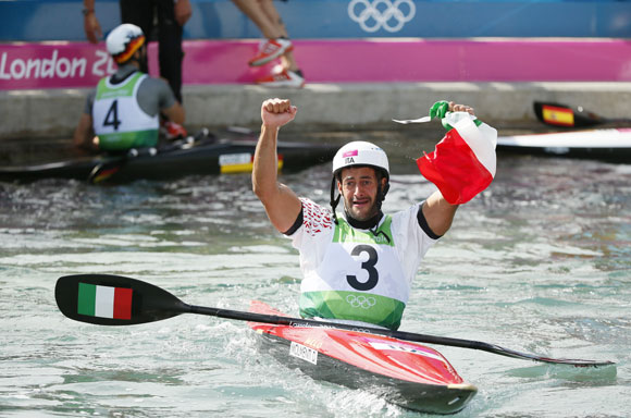 Italy's Daniele Molmenti reacts after his men's kayak (K1) finals run at Lee Valley White Water Centre during the London 2012 Olympic Games