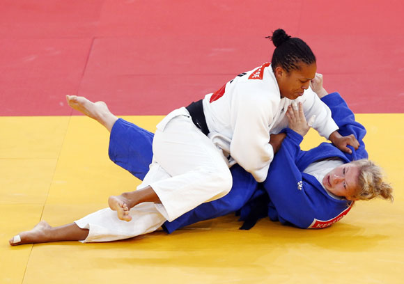 France's Lucie Decosse fights with Germany's Kerstin Thiele (blue) in their women's -70kg final judo match