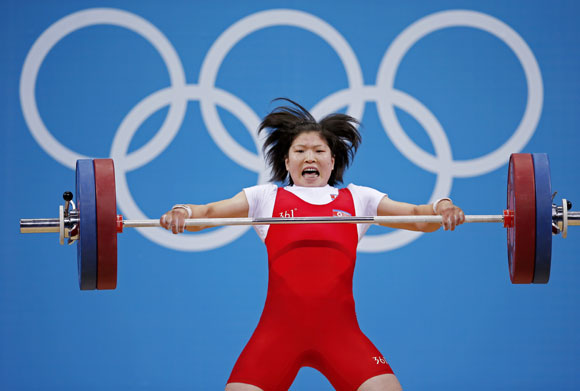 North Korea's Jong Sim Rim competes on the women's 69Kg Group A weightlifting competition
