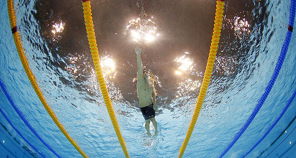 United States' Michael Phelps competes in the men's 4x200-meter freestyle relay swimming final at the Aquatics Centre in the Olympic Park on Tuesday