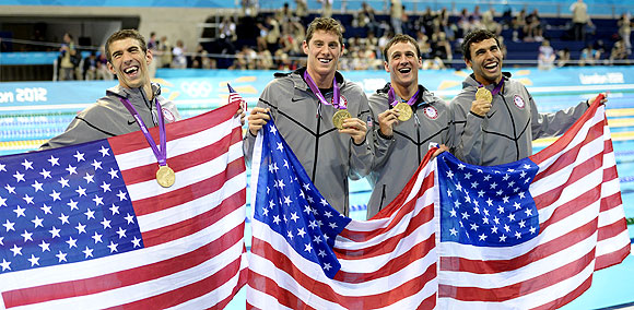 United States' Michael Phelps, Conor Dwyer, Ryan Lochte and Ricky Berens pose with their gold medals after the men's 4x200-meter freestyle relay swimming final on Tuesday