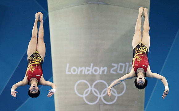China's Chen Ruolin (left) and Wang Hao perform a dive during the women's synchronised 10m platform final on Tuesday