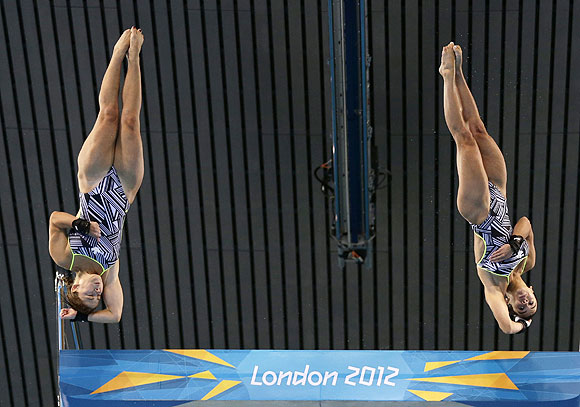 Canada's Roseline Filion (left) and Meaghan Benfeito perform a dive during the women's synchronised 10m platform final on Tuesday