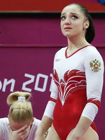 Russian gymnast Kseniia Afanaseva, bottom left, and Aliya Mustafina dejected