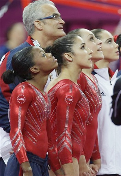 US gymnasts, from left to right, Gabrielle Douglas, Alexandra Raisman, Jordyn Wieber and McKayla Maroney along with US head coach John Geddert