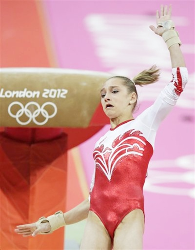 Russian gymnast Victoria Komova performs on the vault