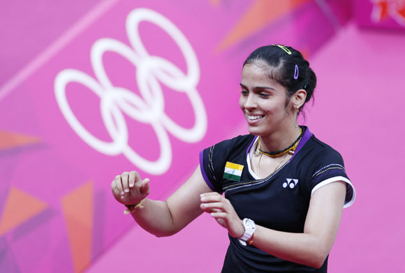 India's Saina Nehwal celebrates winning against Denmark's Tine Baun during their womens singles badminton quarterfinals match