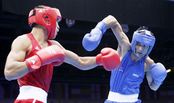 Kazakhstan's Gani Zhailauov (L) fights against India's Jai Bhagwan in their Men's Light (60kg) Round of 16 boxing match