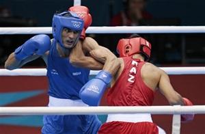 Kazakhstan's Gani Zhailauov, right, fights India's Bhagwan Jai during their men's light 60-kg boxing match