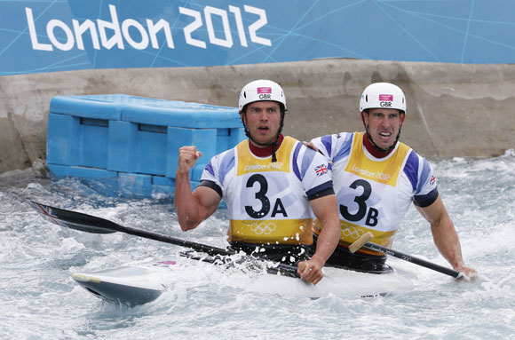 Britain's Tim Baillie (L) and Etienne Stott react to winning the men's canoe double (C2) final at Lee Valley White Water Centre during the London 2012 Olympic Games