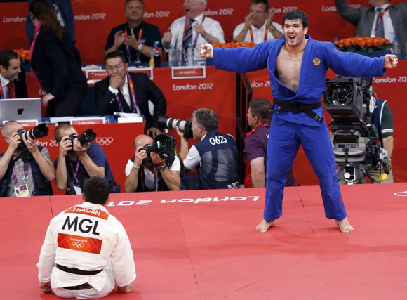 Russia's Tagir Khaibulaev celebrates after defeating Mongolia's Tuvshinbayar Naidan (white) in their men's -100kg final judo match