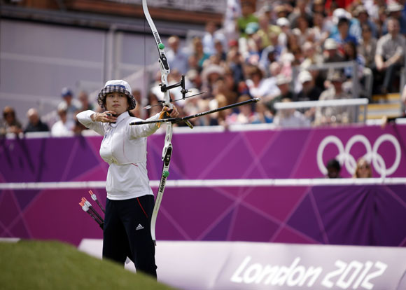 South Korea's Ki Bo-bae shoots during her women's archery individual match