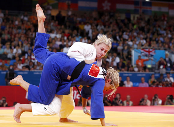 Kayla Harrison of the U.S. fights with Britain's Gemma Gibbons (blue) during their women's -78kg final judo match