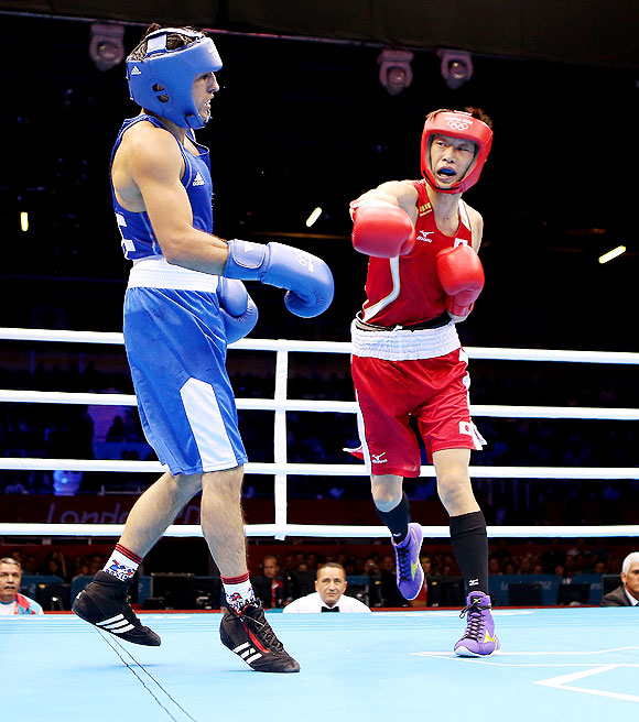 Satoshi Shimizu of Japan (right) in action against Magomed Abdulhamidov of Azerbeijan during the Men's Bantam (56kg) boxing event on Wednesday
