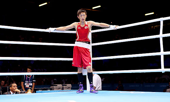Satoshi Shimizu of Japan after his defeat to Magomed Abdulhamidov of Azerbeijan