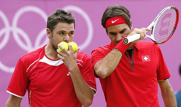 Switzerland's Roger Federer (right) and Stanislas Wawrinka during their men's doubles match against Israel's Andy Ram and Jonathan Erlich during the London 2012 Olympic Games on Wednesday