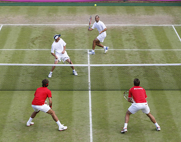 Israel's Andy Ram (top, right) and Jonathan Erlich play a volley against Switzerland's Roger Federer and Stanislas Wawrinka (bottom, right) during their men's doubles match during the London 2012 Olympics on Wednesday